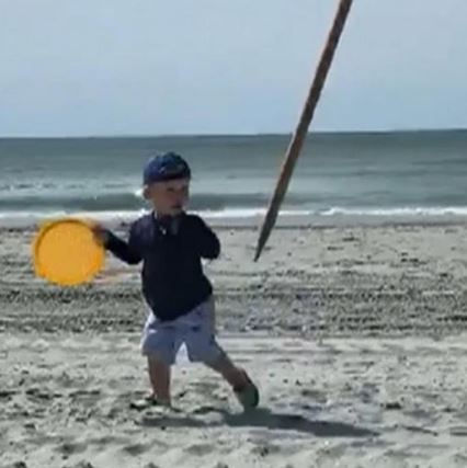 Toddler Almost Impaled by Windblown Beach Umbrella